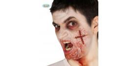 Cicatriz cruz suturada látex con adhesivo líquido
